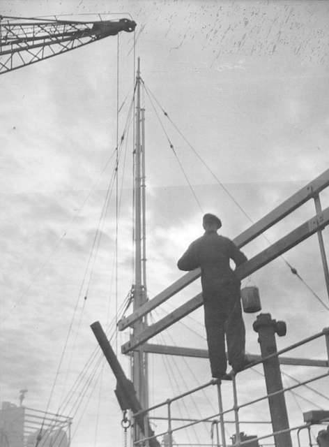 A painter working on a Super Structure at Joseph L Thompson & Sons Ltd