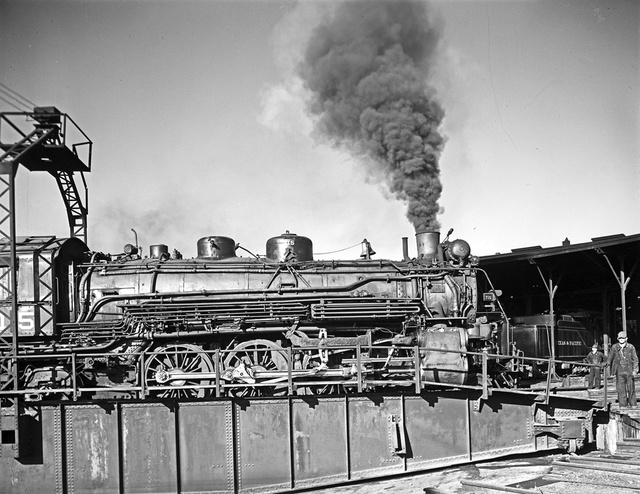 [Locomotive 715 on Turntable, Roundhouse, Texas & Pacific Railway Company]