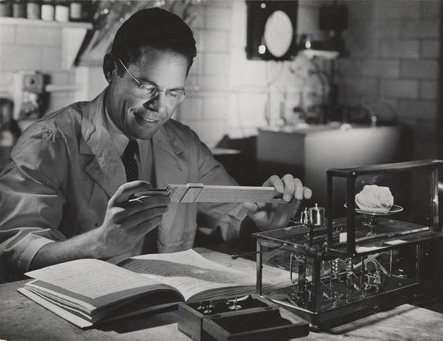 [Employee with slide rule, Hercules Powder Co. Experiment Station, Wilmington, DE]