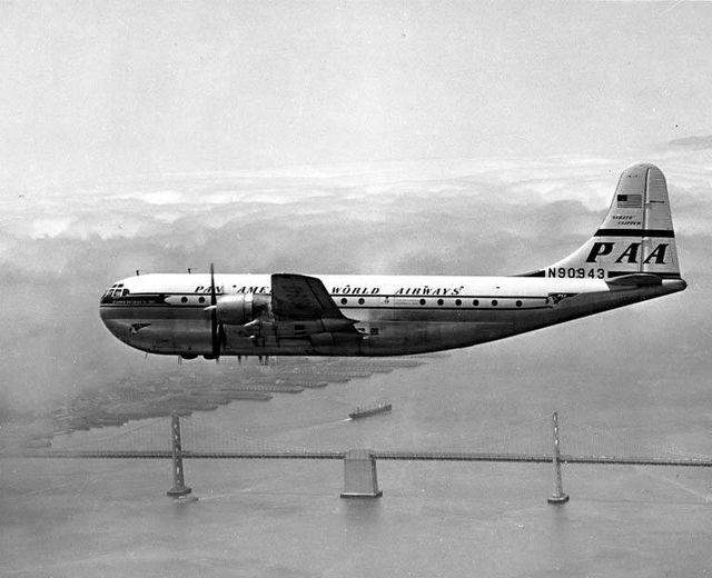 Pan American Airways Boeing 377 Stratocruiser over San Francisco-Oakland Bay Bridge