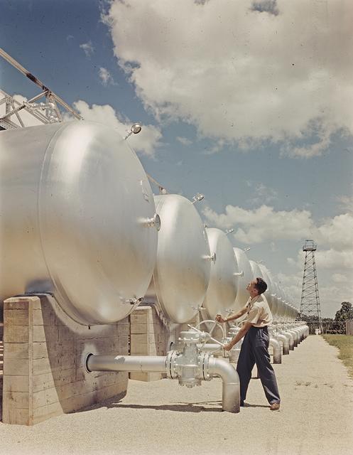 Warren Petroleum Corp., plant man turning Nordstrom valve, Gladewater, Texas