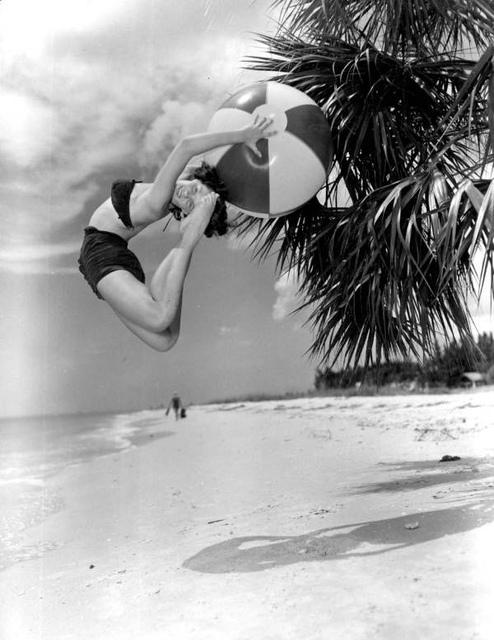 Barbara Hughes cutting a back flip with beach ball (black ballet fashion): Saint Petersburg Beach, Florida