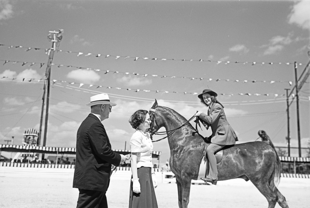 [Contestant Receiving Award Ribbon, Breed Show Schooling Event, Pin Oak Charity Horse Show]