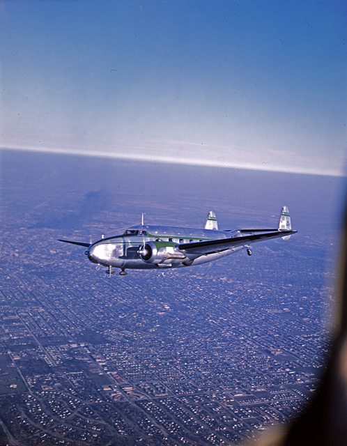 [Lockheed Model 18 Lodestar, Banking in Flight, James S. Abercrombie Company]