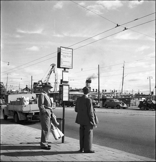 Men waiting for the bus at Skeppsbron in Stockholm 1950