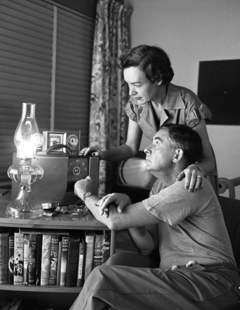 Philip and Frederica Wylie listening to weather reports: Miami Beach, Florida