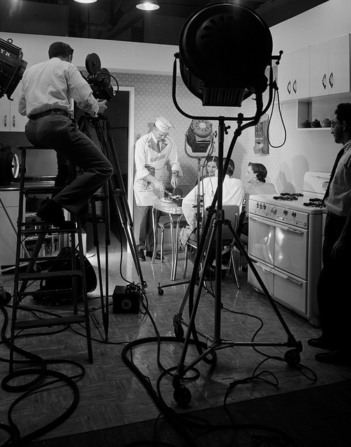 [Filming Actors at Table, Motion Picture Kitchen Set, Texas-Illinois Co.]