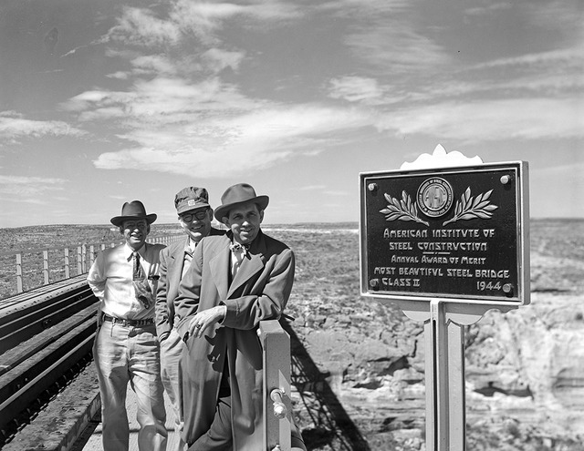 [Men Standing by Historical Marker, Pecos River High Bridge, Southern Pacific Railroad Company]