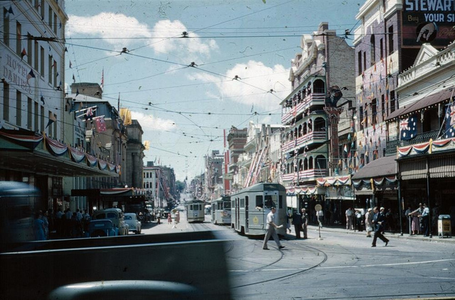 View along Adelaide Street with the buildings decorated for the Royal Visit, 1954