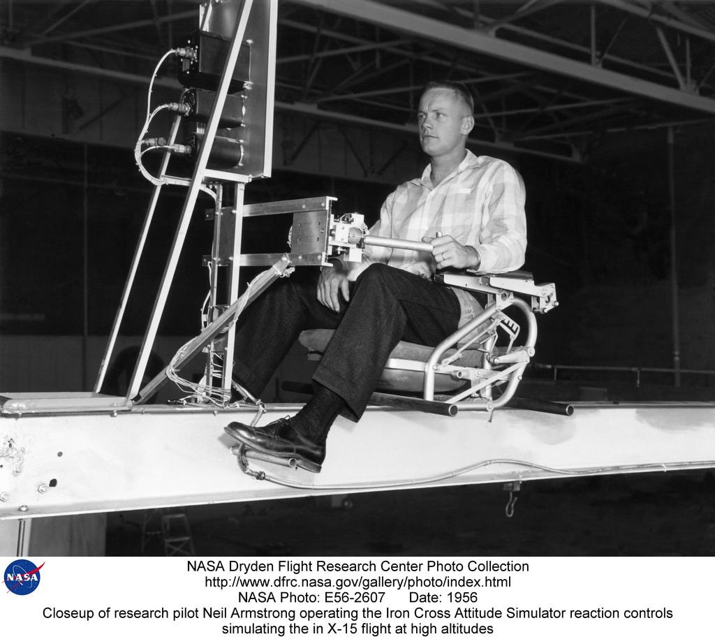 Closeup of research pilot Neil Armstrong operating the Iron Cross Attitude Simulator reaction contro