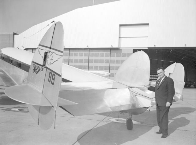 Melvin Gough at the Tail of a NACA Lockheed Plane
