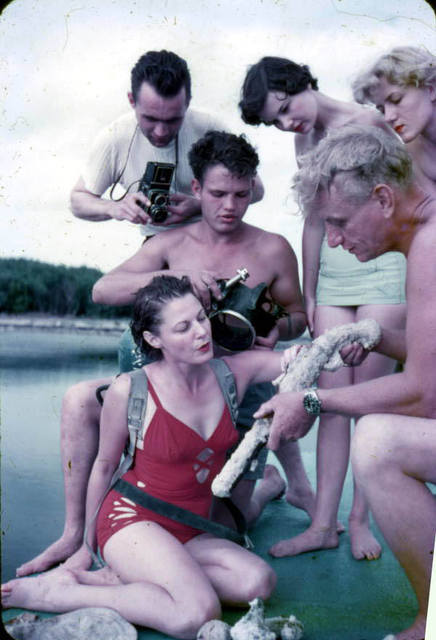 Art McKee showing group the coral encrusted pistol he found - Plantation Key