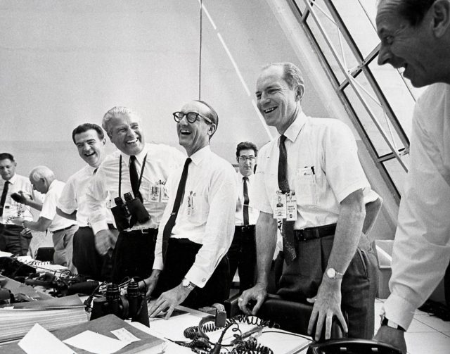 NASA officials, (left to right) Charles W. Mathews; Dr. Wernher von Braun, Director, Marshall Space Flight Center (MSFC); Dr. George E. Mueller, Associate Administrator for Marned Space Flight; and Air Force Lt. General Samuel C. Phillips, Apollo Program Director celebrate the successful launch of Apollo 11 in the control room at Kennedy Space Center (KSC) on July 16, 1969. Boosted by the Saturn V launch vehicle, the Apollo 11 mission with a crew of three: Astronauts Neil A. Armstrong, Michael Collins, and Edwin E. Aldrin, made the first manned lunar landing. The Saturn V vehicle was developed by Marshall Space Flight Center (MSFC) under the direction of Dr. von Braun. n/a