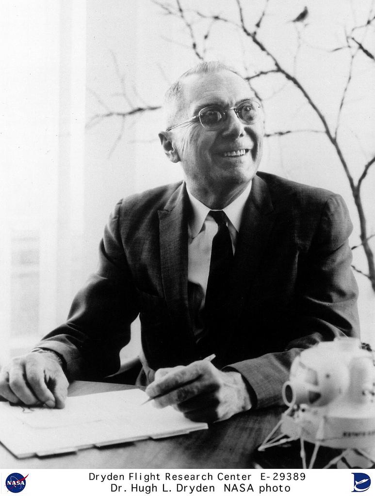 Dr. Hugh L. Dryden seated at desk