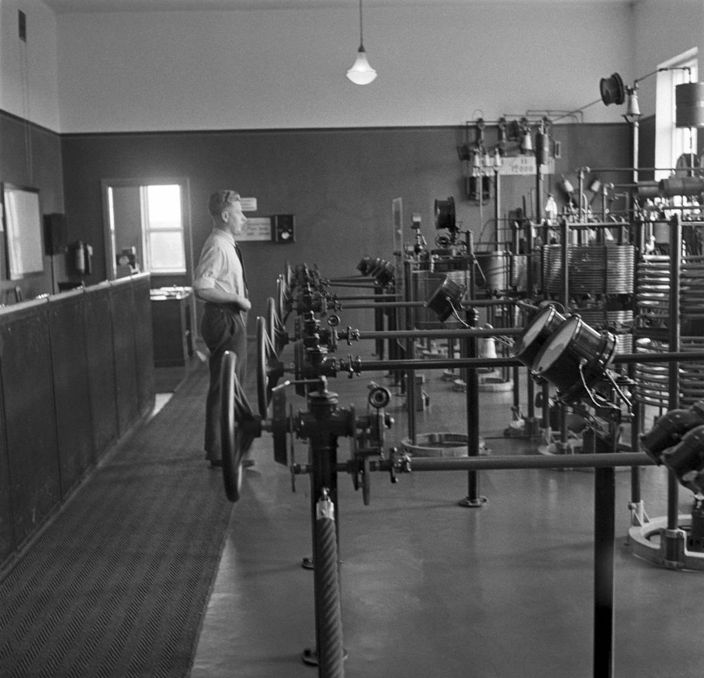 Engineer Eero Frantsila beside Telefunken transmission equipment in Lahti radio station, 1930's.
