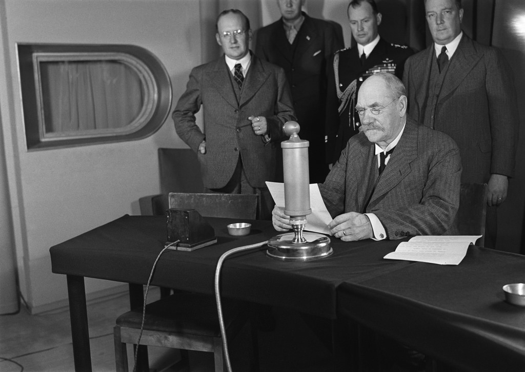President of Finland Pehr Evind Svinhufvud in a radio studio giving a speech to honour the 10th anniversary of the Finnish Broadcasting Company, 1936.
