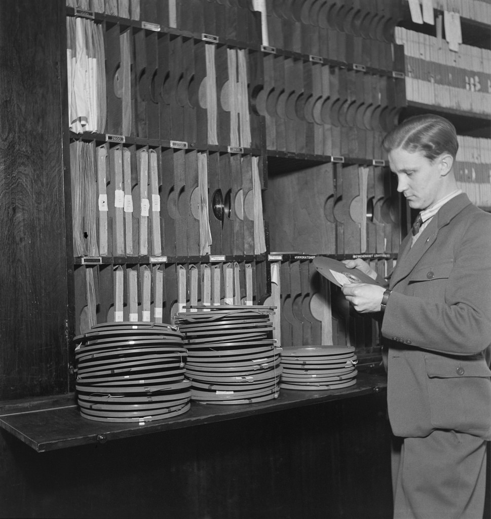 Sound archives. An unknown man handles tapes in tape library.