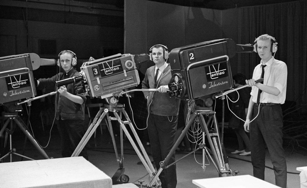 Tamvision's camera operators Kauno Peltola, Lasse Koskinen and Tuomo Kurikka pose next to television cameras at Frenckell's studio in Tampere, 1.2.1965