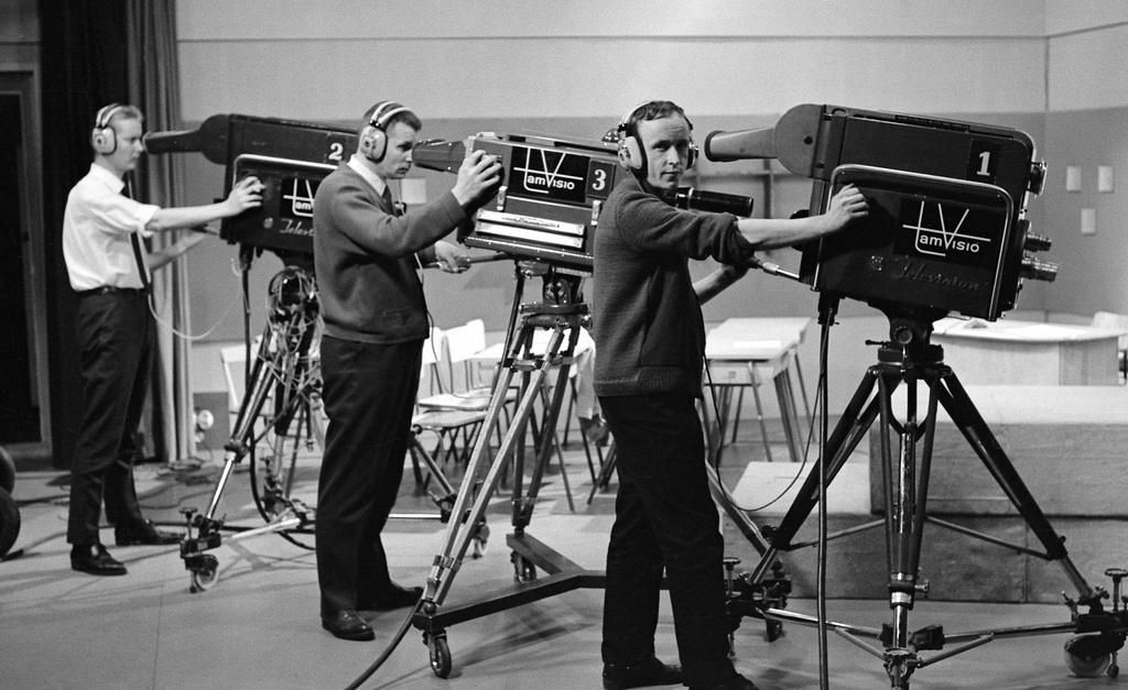 Tamvision's camera operators Tuomo Kurikka, Lasse Koskinen and Kauno Peltola pose next to television cameras at Frenckell's studio in Tampere, 1.2.1965