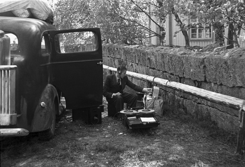 Technician recording a radio programme by a broadcast van for sound, 1939.