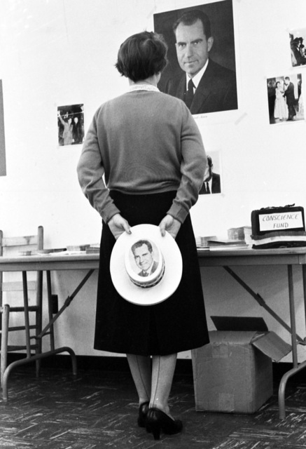 Woman viewing portrait of Nixon - Tallahassee