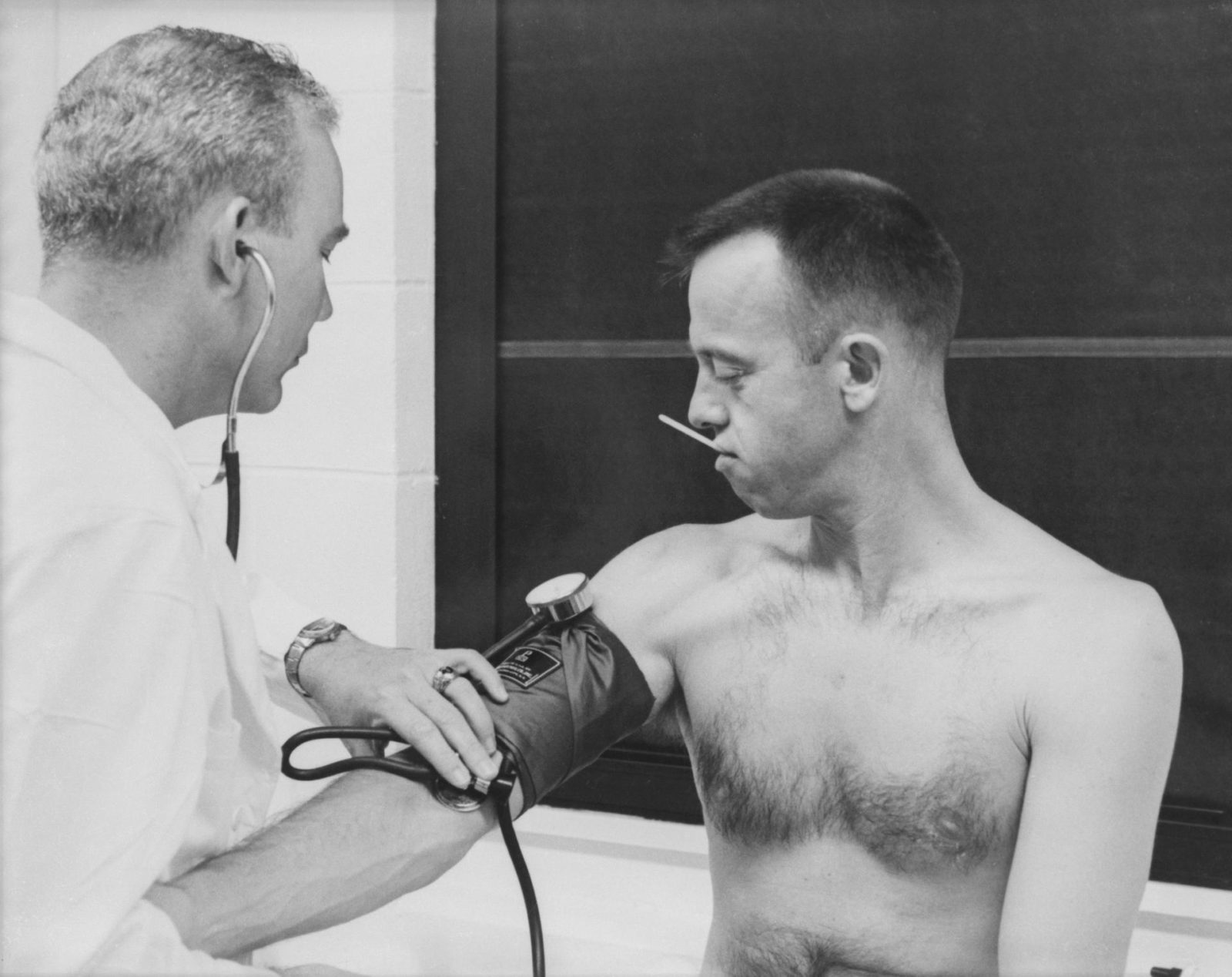 Astronaut Alan B. Shepard has his blood pressure and temperature checked