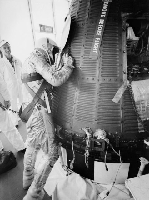 Astronaut Alan Shepard in pressure suit with Freedom 7 capsule