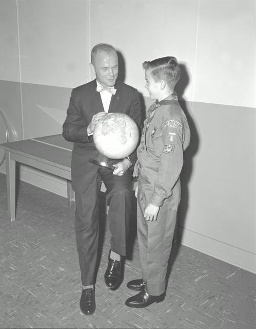 S62-00992 (1961) --- Mercury astronaut John Glenn looks into a Celestial Training Device (globe) during training in the Aeromedical Laboratory at Cape Canaveral, Florida. s62_00992