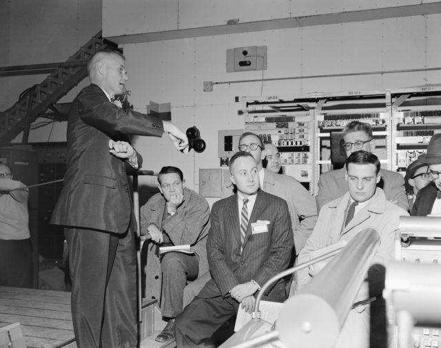 Astronaut John Glenn and news media representatives during tour of Cape