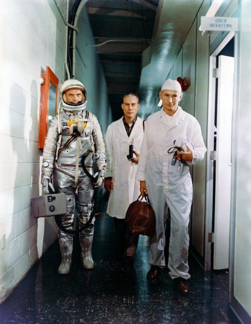 Astronaut John Glenn leaving crew quarters prior to launch