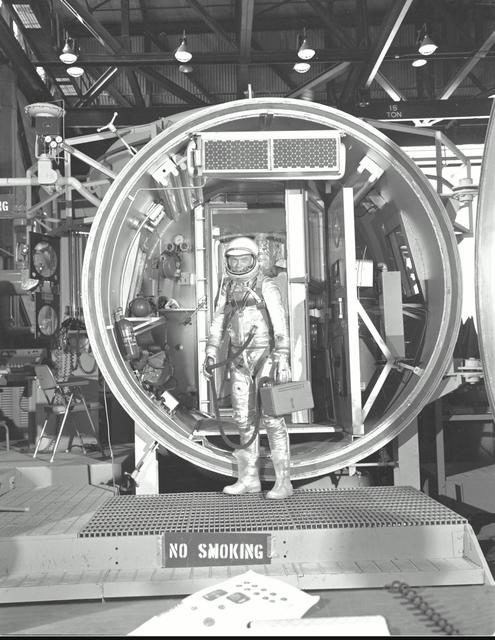 Astronaut John Glenn, suited, during altitude chamber test