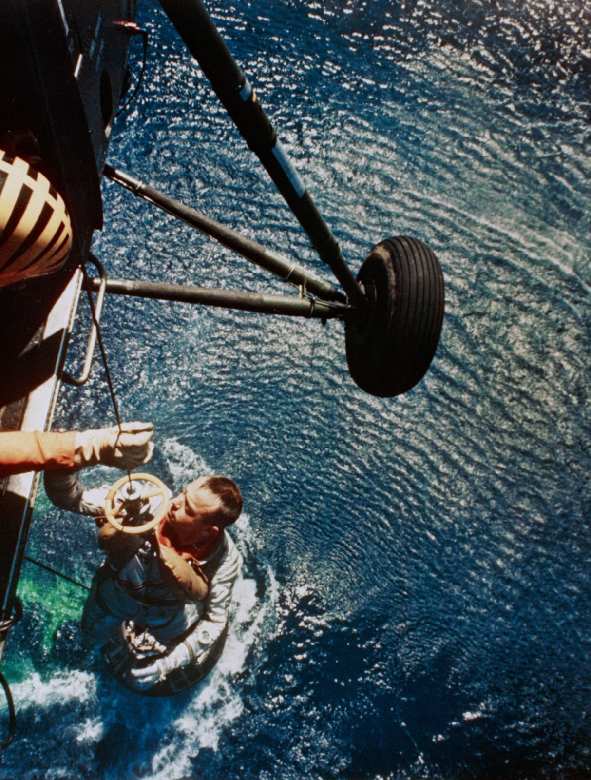 Astronaut Alan Shepard is rescued by helicopter at end of MR-3 flight