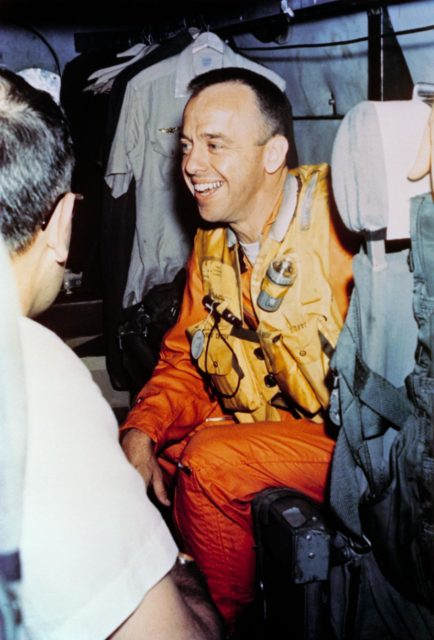 Astronaut Alan Shepard onboard helicopter after recovery of Mercury capsule
