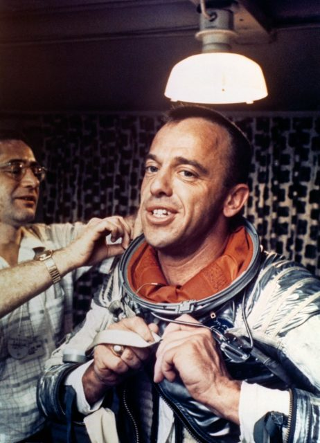 Astronaut Alan Shepard removing space suit on U.S. Champlain after recovery