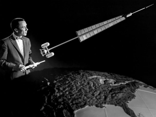 Researcher Poses with a Nuclear Rocket Model
