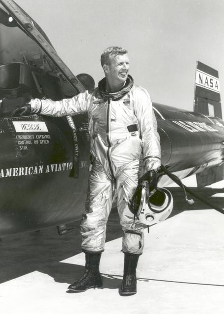Joe Walker beside an X-15 Airplane