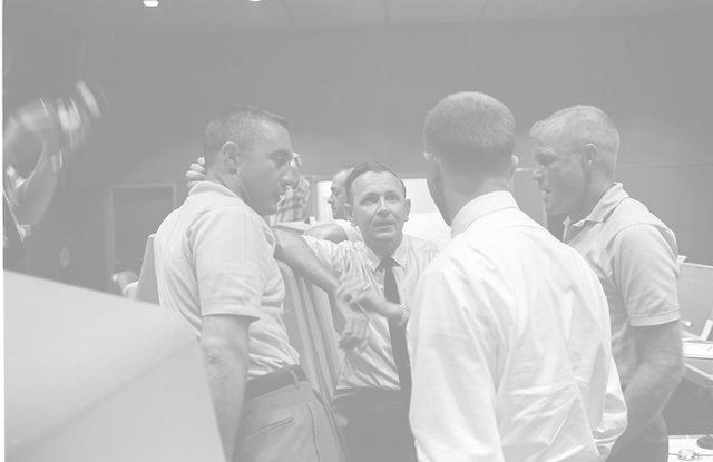 Astronauts Grissom and Glenn hold discussion in Mercury Control Center
