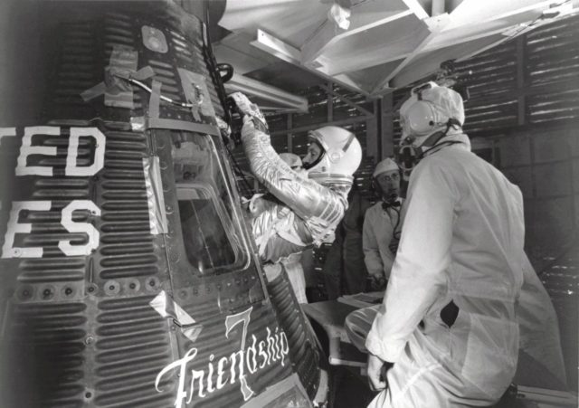 """CAPE CANAVERAL, Fla. -- Astronaut John H. Glenn Jr. enters his Mercury capsule, """"Friendship 7,"""" as he prepares for launch of the Mercury-Atlas rocket. On February 20, 1962, Glenn lifted off into space aboard his Mercury Atlas 6 MA-6 rocket and became the first American to orbit the Earth. After orbiting the Earth 3 times, Friendship 7 landed in the Atlantic Ocean 4 hours, 55 minutes and 23 seconds later, just East of Grand Turk Island in the Bahamas. Glenn and his capsule were recovered by the Navy Destroyer Noa, 21 minutes after splashdown.      Photo credit: NASA KSC-S63-01207"""