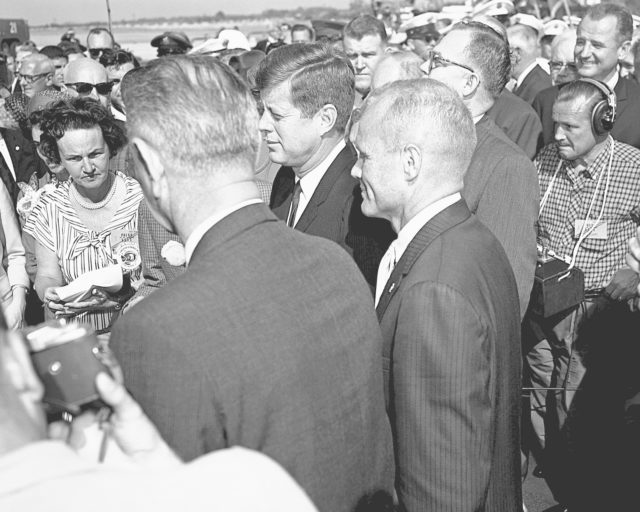 CAPE CANAVERAL, Fla. -- President John F. Kennedy honors John H. Glenn Jr. during welcome back ceremonies at Patrick Air Force Base and Cape Canaveral in Florida after his historic three-orbit mission aboard Friendship 7. Vice President Lyndon B. Johnson looks on, with his back to the camera. Photo credit: NASA KSC-PL62-76872