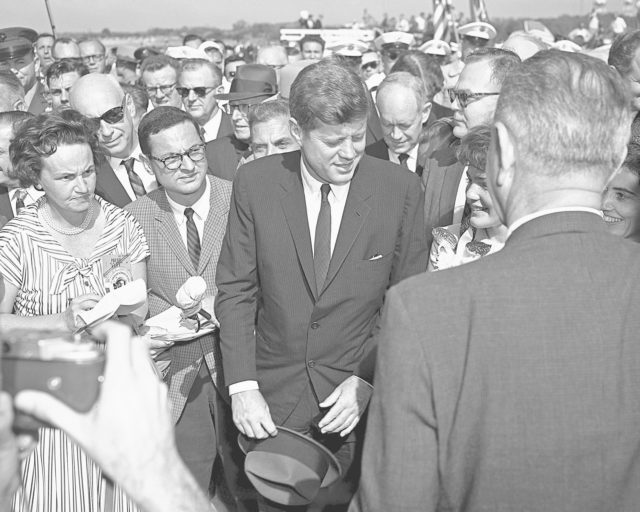 CAPE CANAVERAL, Fla. -- President John F. Kennedy honors John H. Glenn Jr. during welcome-back ceremonies at Patrick Air Force Base and Cape Canaveral in Florida after his historic three-orbit mission aboard Friendship 7. Vice President Lyndon B. Johnson also is in attendance, with his back to the camera. Photo credit: NASA KSC-PL62-76874