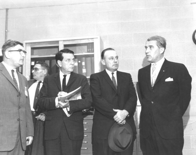 The members of the House Committee on Science and Astronautics visited the Marshall Space Flight Center (MSFC) on March 9, 1962 to gather firsthand information of the nation's space exploration program. The congressional group was composed of members of the Subcommittee on Manned Space Flight. They were briefed on MSFC's manned space efforts earlier in the day and then inspected mockups of the Saturn I Workshop and the Apollo Telescope Mount, two projects developed by MSFC for the post-Apollo program. Pictured left-to-right are Dieter Grau, MSFC; Konrad Dannenberg, MSFC; James G. Fulton, Republican representative for Pennsylvania; Joe Waggoner, Democratic representative for Louisiana; and Dr. Wernher von Braun, Director of MSFC. n/a