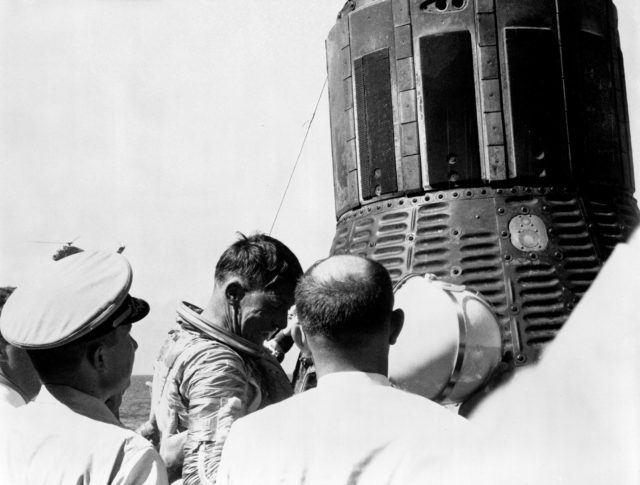 Astronaut Walter Schirra being removed from his Sigma 7 capsule