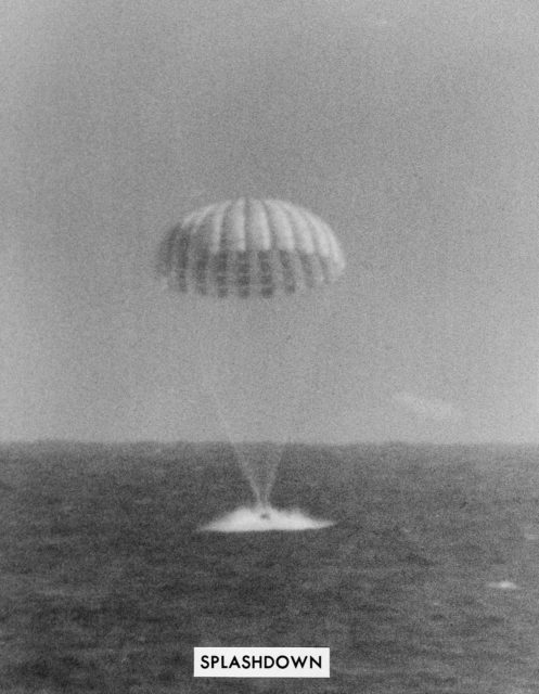 Landing of Mercury-Atlas 8 spacecraft with parachute extended