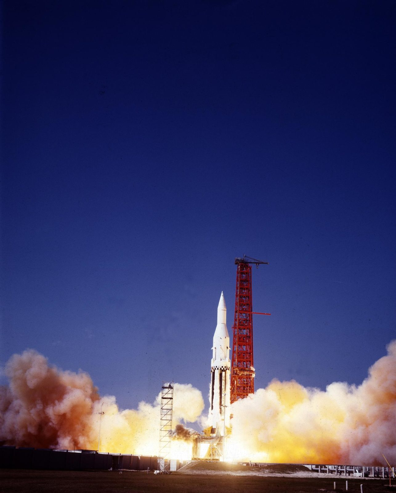 """The Saturn I (SA-4) flight lifted off from Kennedy Space Center launch Complex 34, March 28, 1963. The fourth launch of Saturn launch vehicles, developed at the Marshall Space Flight Center (MSFC) under the direction of Dr. Wernher von Braun, incorporated a Saturn I, Block I engine. The typical height of a Block I vehicle was approximately 163 feet and had only one live stage. It consisted of eight tanks, each 70 inches in diameter, clustered around a central tank, 105 inches in diameter. Four of the external tanks were fuel tanks for the RP-1 (kerosene) fuel. The other four, spaced alternately with the fuel tanks, were liquid oxygen tanks as was the large center tank. All fuel tanks and liquid oxygen tanks drained at the same rates respectively. The thrust for the stage came from eight H-1 engines, each producing a thrust of 165,000 pounds, for a total thrust of over 1,300,000 pounds. The engines were arranged in a double pattern.  Four engines, located inboard, were fixed in a square pattern around the stage axis and canted outward slightly, while the remaining four engines were located outboard in a larger square pattern offset 40 degrees from the inner pattern. Unlike the inner engines, each outer engine was gimbaled. That is, each could be swung through an arc. They were gimbaled as a means of steering the rocket, by letting the instrumentation of the rocket correct any deviations of its powered trajectory. The block I required engine gimabling as the only method of guiding and stabilizing the rocket through the lower atmosphere. The upper stages of the Block I rocket reflected the three-stage configuration of the Saturn I vehicle. Like SA-3, the SA-4 flight's upper stage ejected 113,560 liters (30,000 gallons) of ballast water in the upper atmosphere for """"Project Highwater"""" physics experiment. Release of this vast quantity of water in a near-space environment marked the second purely scientific large-scale experiment. The SA-4 was the last Block I rocket launc"""