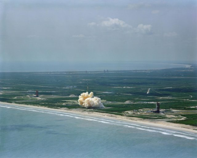 Aerial view Gemini/Titan-II launch vehicle #1 liftoff at Cape Kennedy