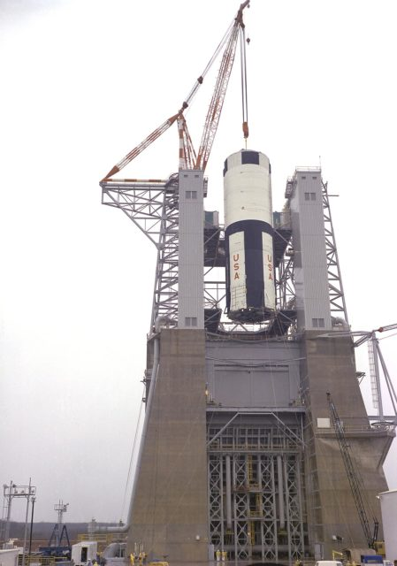 Saturn V - S-IC-T stage is hoisted into the S-IC static test stand