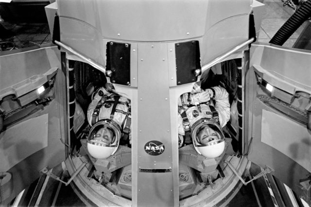 Astronauts Grissom and Young prepare to preform flight simulations