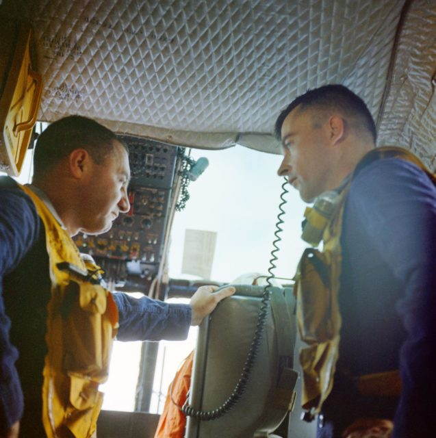 Astronauts Grissom and Young aboard helicopter after retrieval from Gemini 3