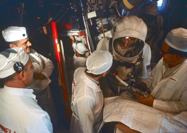 Gemini 7 backup crew seen in white room during Gemini 7 simulation activity