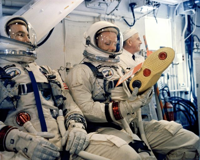 KSC-66C-1875 Astronauts David Scott and Neil Armstrong wait for the order to board their Gemini 8 Spacecraft in the White Room at Cape Kennedy, Complex 19. (jrs) 104-KSC-66C-1875